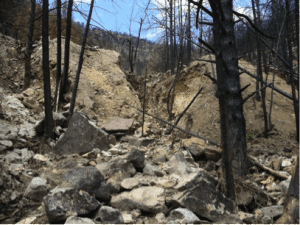 Erosion of mine tailings in 2011 after Fourmile fire (from Murphy, 2011) and battered pickup in September 2013 flood debris, Fourmile Canyon, Colorado